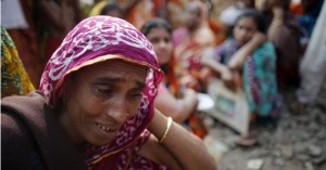 Andrew Biraj/Reuters – A relation of a garment worker, who is still missing after the Rana Plaza building collapse, cries during a protest in front of the site. Hundreds of garment workers and activists gathered in front of the Rana Plaza site seven months after its collapse.