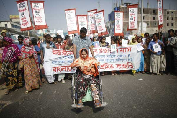 Andrew Biraj/Reuters – Survivors and relatives of the garment workers, who died in the Rana Plaza building collapse and in the fire of Tazreen Fashions factory, take part in rally in Bangladesh.