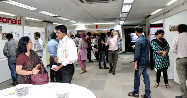 Stalls of the initiative's partnering civil society organisations at the Brac Centre Inn demonstrate on-going activities concerning the post-Rana Plaza follow-up