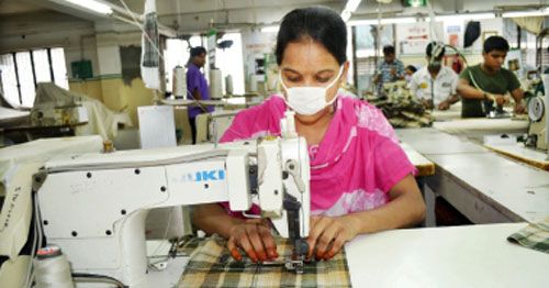 A file photo shows workers busy at a readymade garment factory in Dhaka. Export earnings in the first two months of the current financial year fell 9.16 per cent short of the government-set target of $5.66 billion, according to the Export Promotion Bureau data released on Sunday. — New Age photo