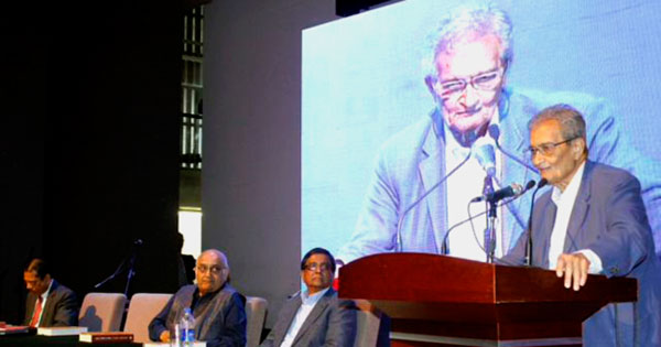 Amrtya Sen (right) addresses the audience with (from right) Rehman Sobhan, Matiur Rahman (and Mustafizur Rahman on stage.