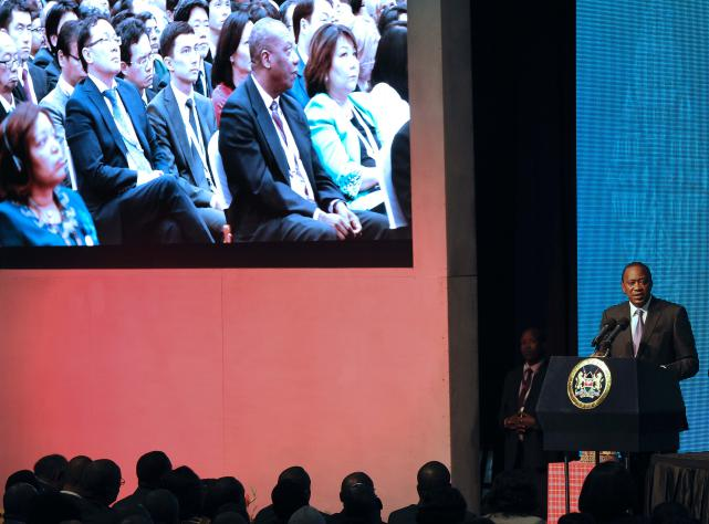 Kenya's President Uhuru Kenyatta addresses delegates at the official opening of the Tenth World Trade Organisation ministerial conference. Photo: AFP