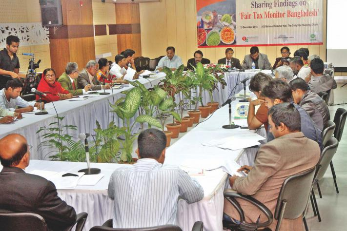 Analysts take part in a discussion on tax monitoring, organised by SUPRO, a nongovernmental organisation, at The Daily Star Centre yesterday. Photo: Star