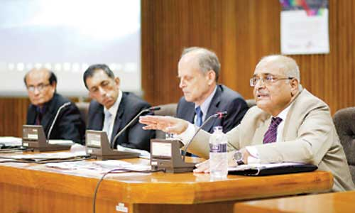 Centre for Policy Dialogue distinguished fellow Debapriya Bhattacharya makes a point at the report launching ceremony of the 'Economic and Social Survey of Asia and the Pacific 2016' of the United Nations Economic and Social Commission for Asia and the Pacific at IDB Bhaban in Dhaka on Thursday. UN resident coordinator in Bangladesh Robert D Watkins and UN ESCAP economic affairs officer Shuvojit Banerjee were also present. — New Age photo
