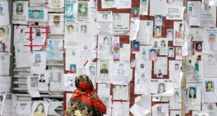 a_woman_looks_at_a_wall_filled_with_portraits_of_missing_people_on_may_3_2013_near_the_collapsed_rana_plaza_building._photo_ashraful_alam_tito_associated_press